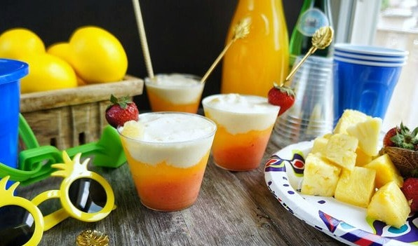 Layered mango coconut mocktails! The tropical flavor and frosty chill are the perfect combination for a fun summer drink!