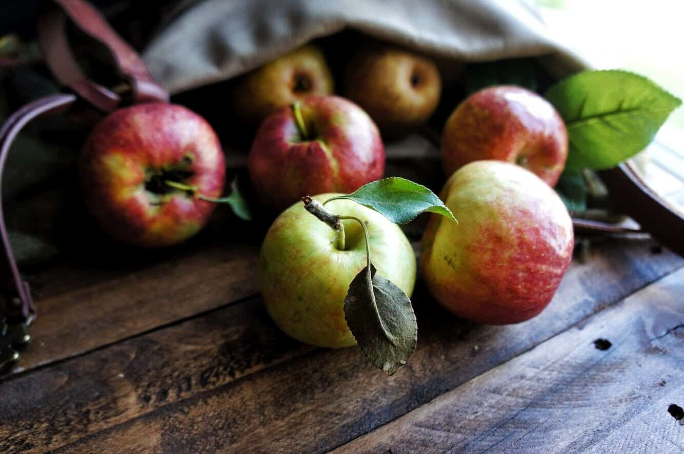 orchard apples spilling out of a bag