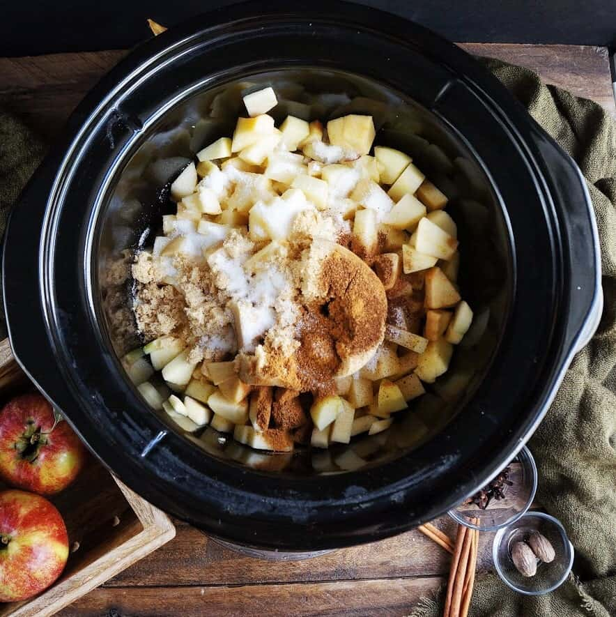 Apple butter ingredients in a slow cooker