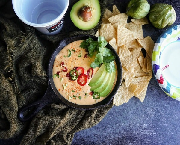 This addicting queso dip that will please your guests even when the touchdowns aren't happening.