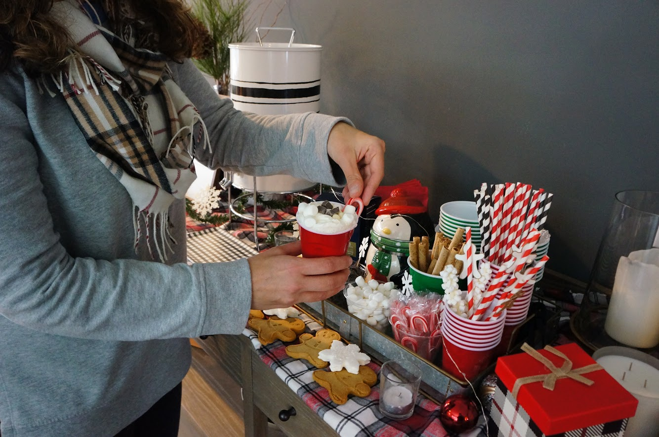 adding candy cane to hot cocoa