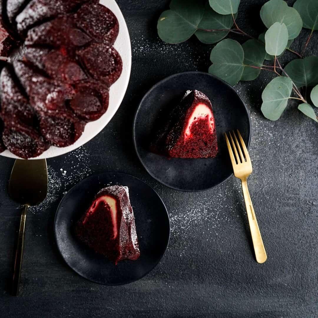 red velvet cream cheese bundt cake slices on dessert plates with fork
