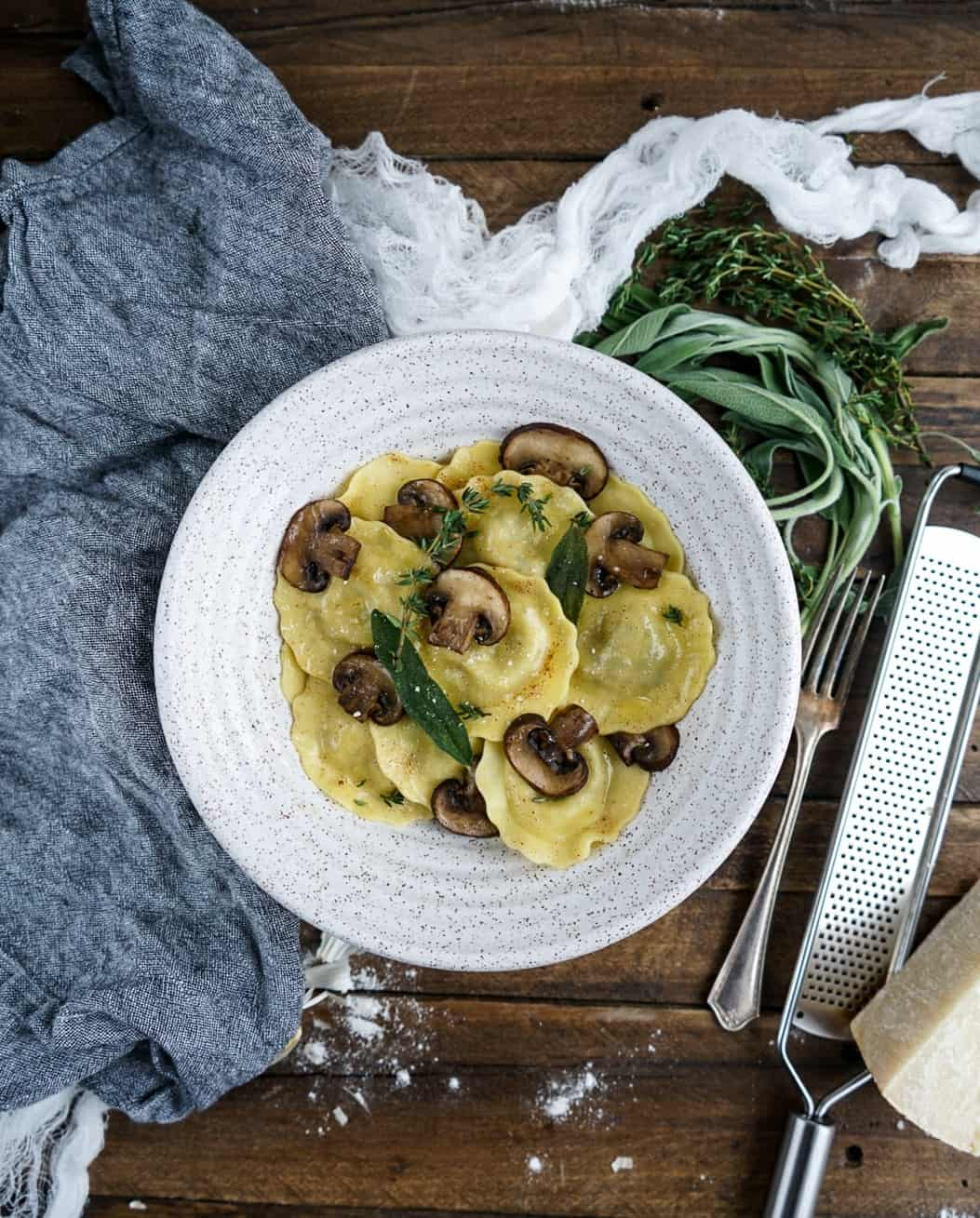 Mushroom Ravioli with Brown Butter Sauce plated in bowl