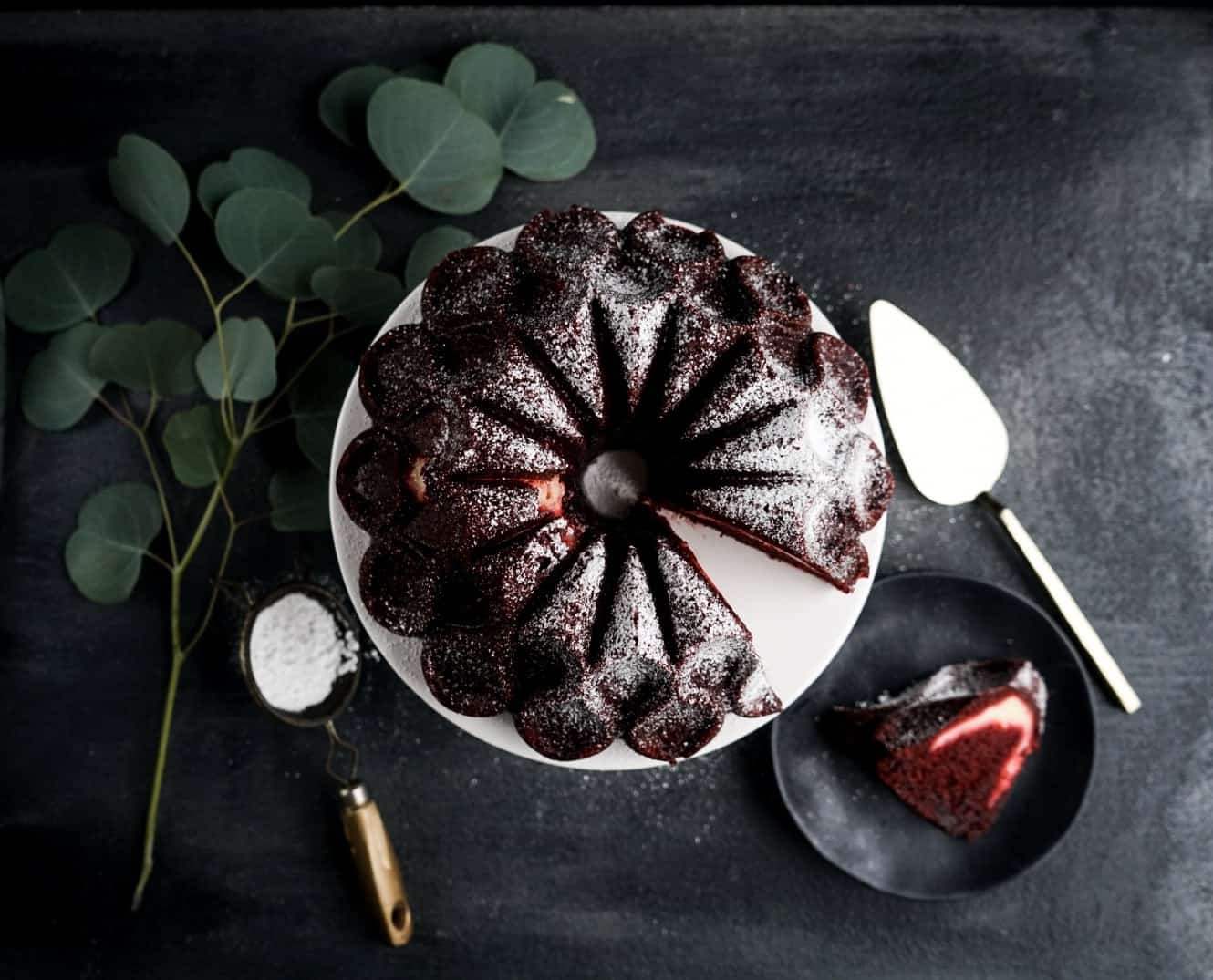 red velvet cream cheese bundt cake with a slice taken out