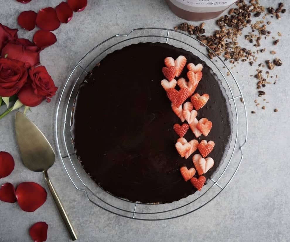 gluten free and vegan double chocolate tart with strawberries on top