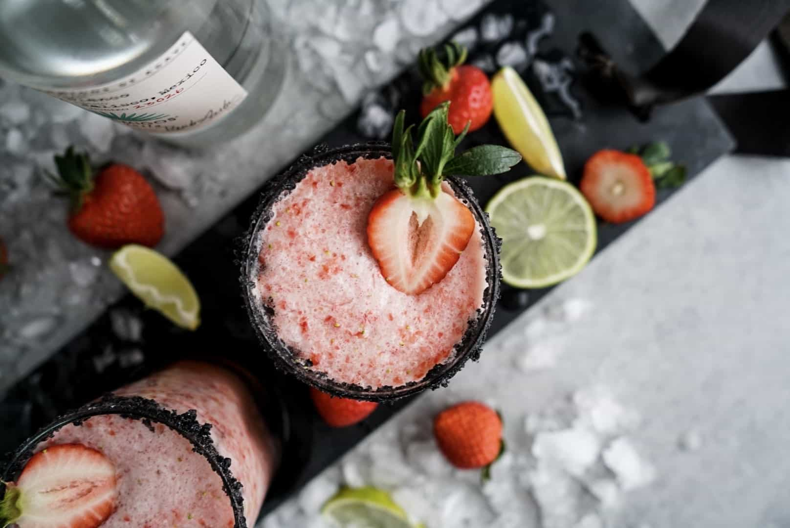 Strawberry Lime Margaritas garnished with salt and fresh strawberries