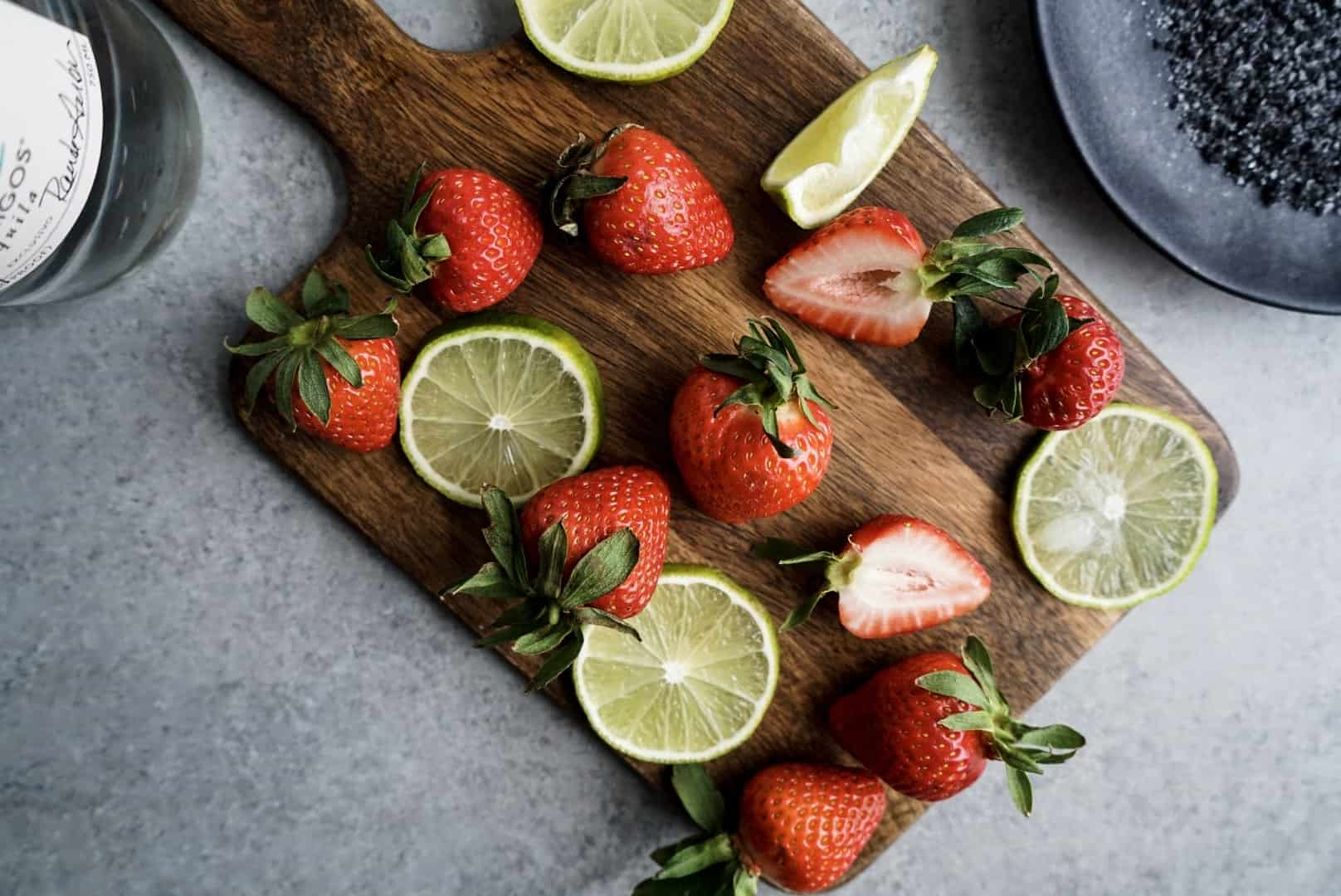 fresh strawberries and limes