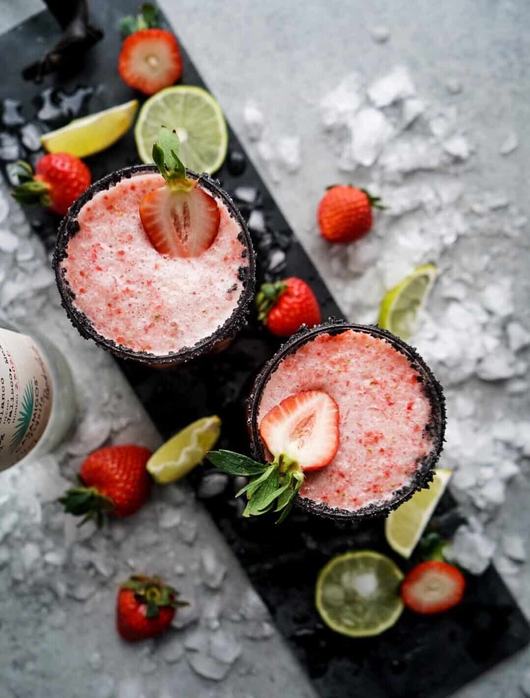 Strawberry Lime Margaritas on serving platter garnished with fresh strawberries and ice