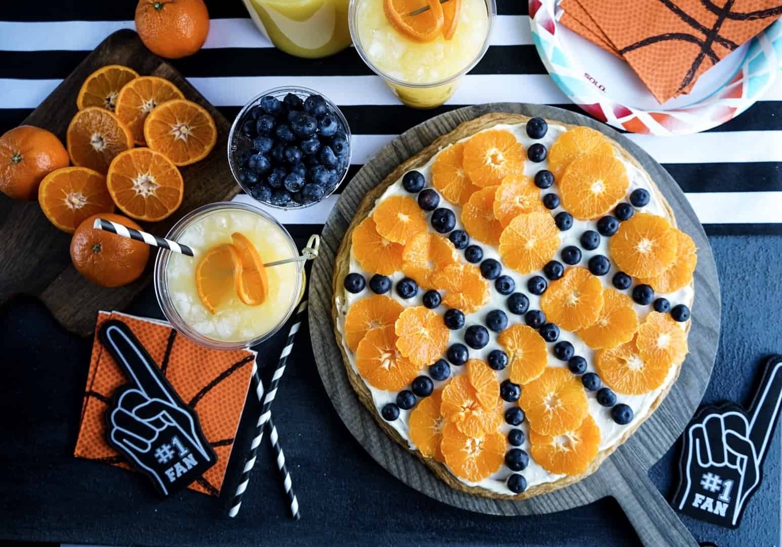 basketball fruit pizza assembled on cutting board
