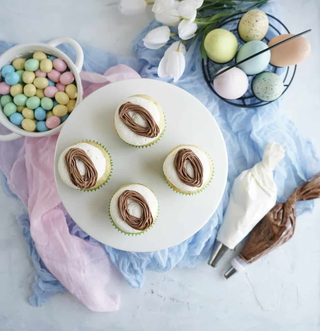 easter nests piped on Easter egg cupcakes