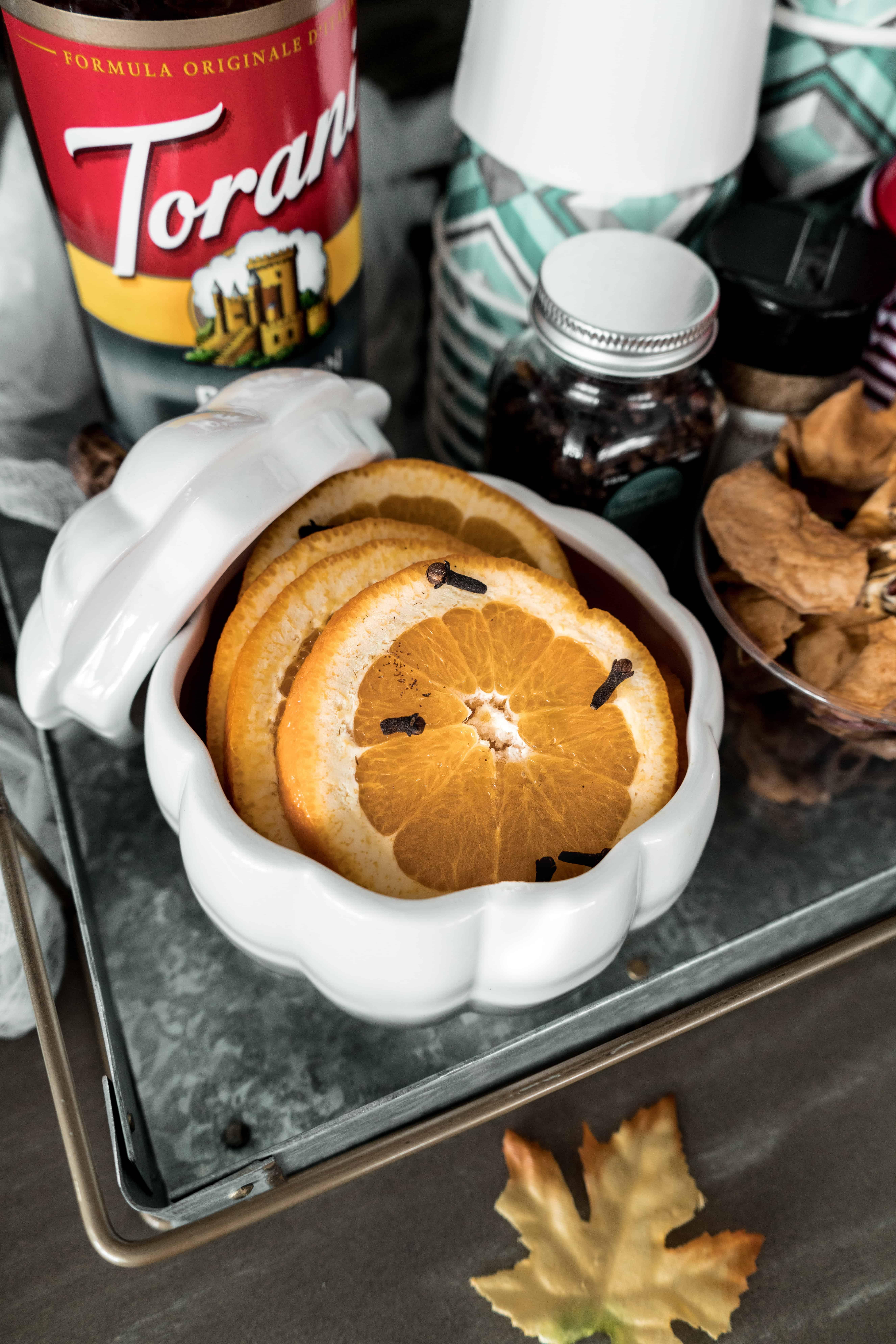 apple cider bar toppings displaying oranges
