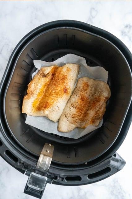 white fish in air fryer basket