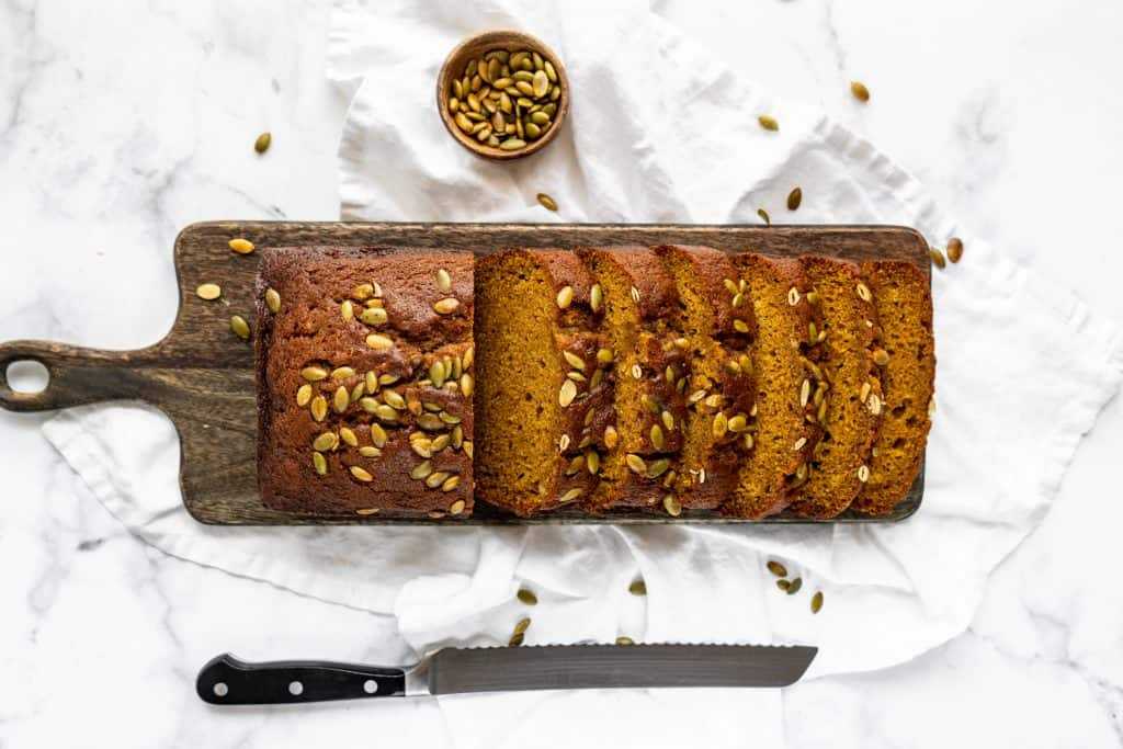 pumpkin bread sliced on cutting board