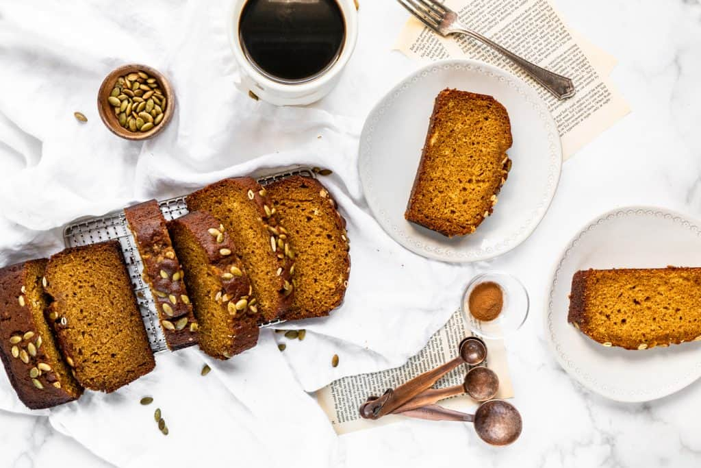 pumpkin bread sliced and two pieces on plates