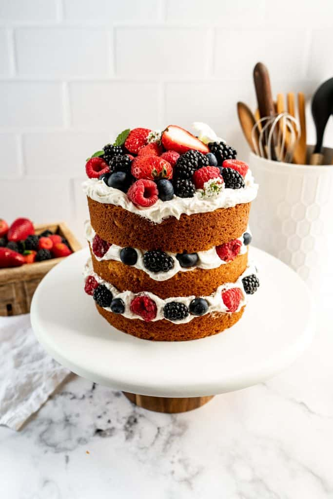 lemon berry layer cake on stand