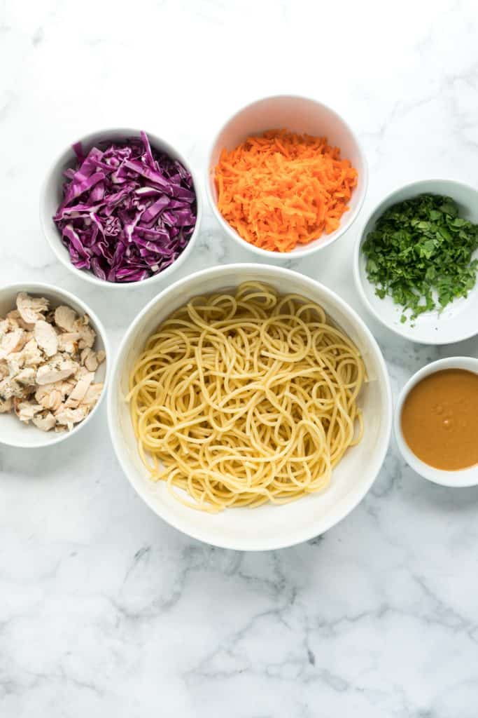 spicy peanut noodle ingredients separated in bowls