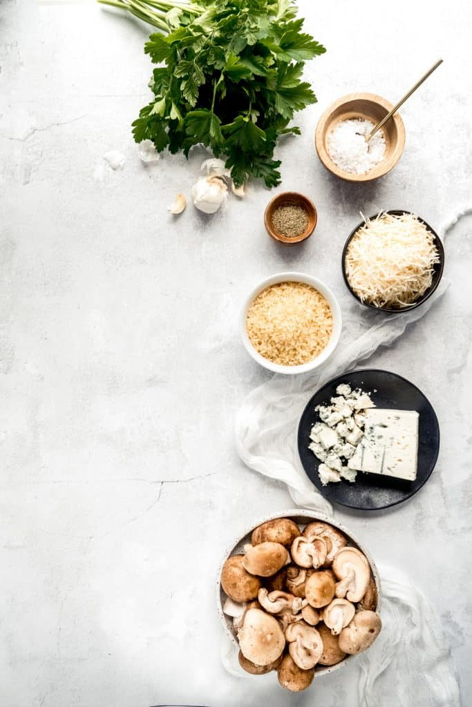 Instant pot Mushroom Gorgonzola risotto ingredients in bowls on background