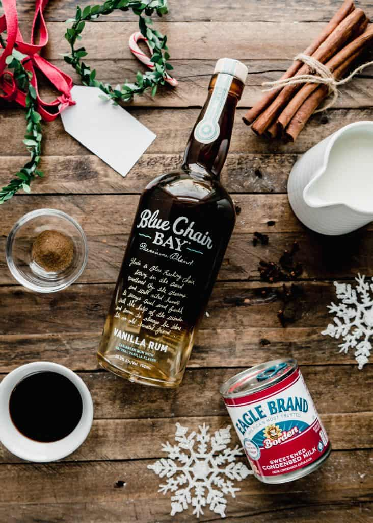 gingerbread coquito ingredients on wood board