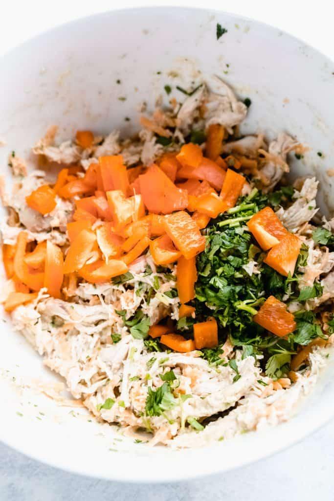 healthier chicken enchiladas ingredients in mixing bowl