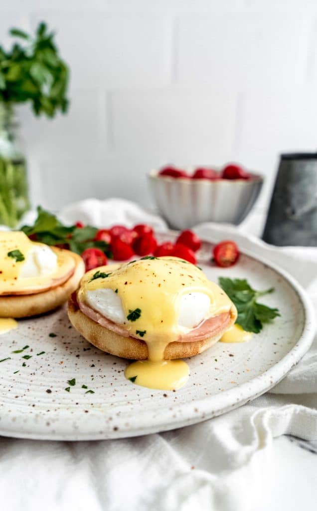 eggs benedict with citrus hollandaise on plate