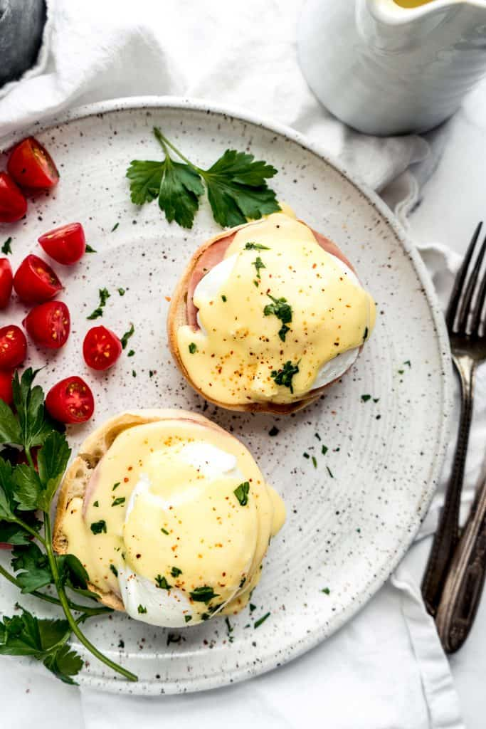 overhead shot of eggs benedict with citrus hollandaise on plate