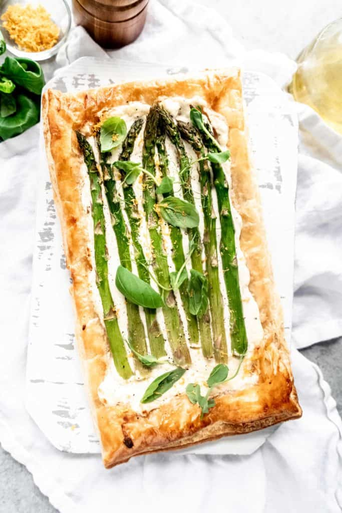fully baked asparagus goat cheese tart on cutting board
