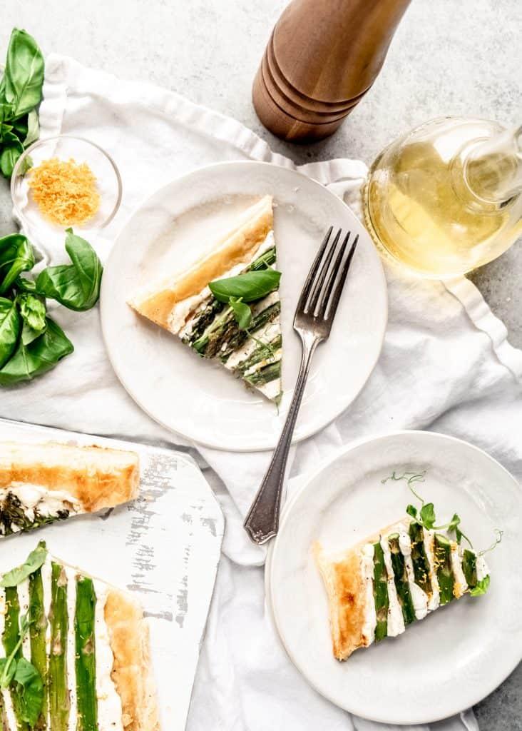 asparagus goat cheese tart sliced on plates