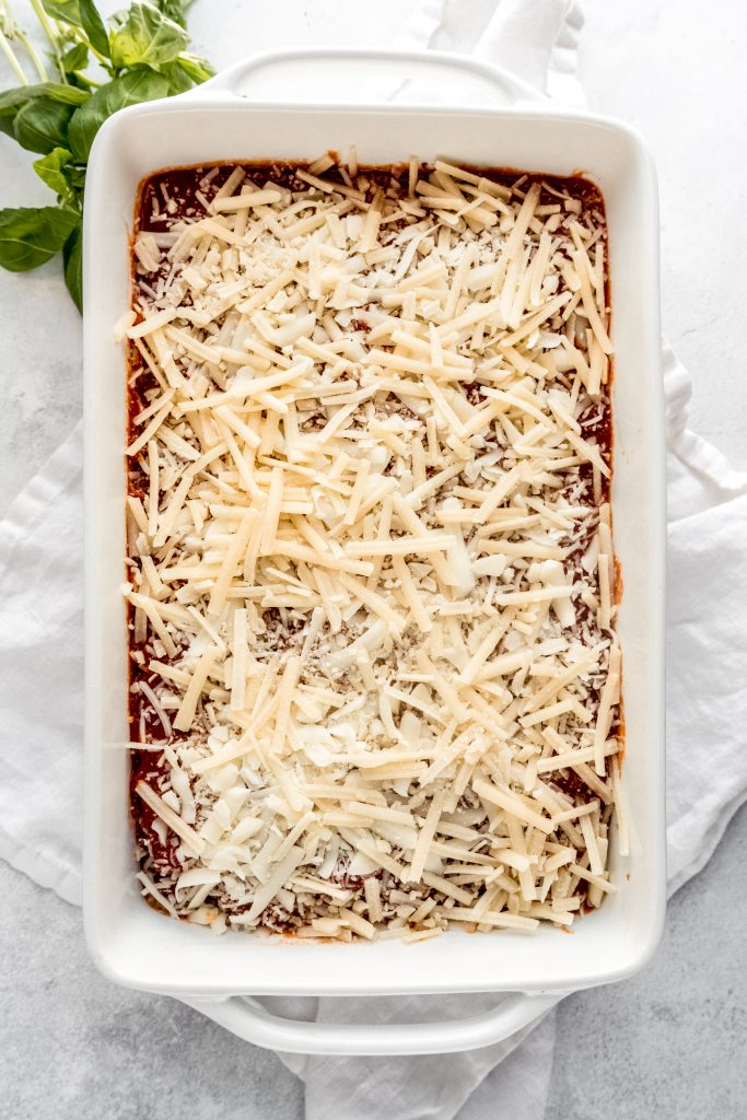 lasagna in baking dish before going into oven