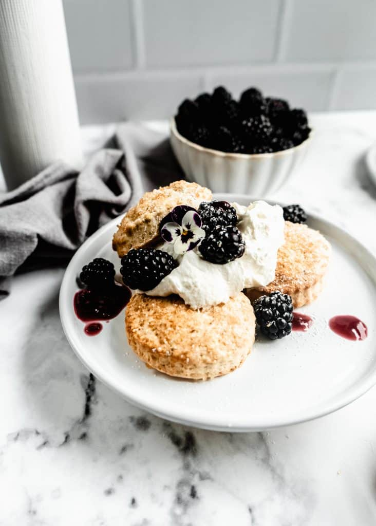 lavender blackberry shortcakes assembled on plate
