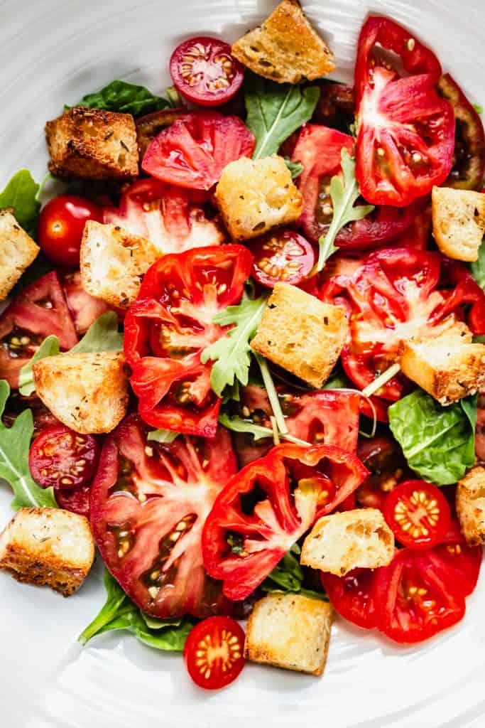 close up shot of panzanella salad in serving bowl
