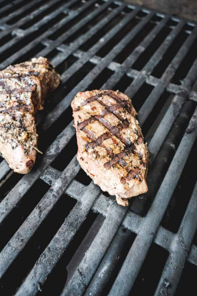 cooked steak on grill with grill marks