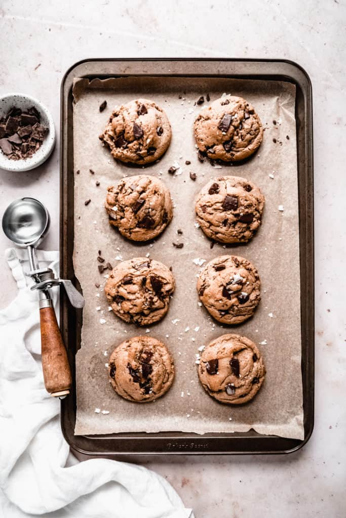 brown butter toffee chocolate chunk cookies baked on baking sheet